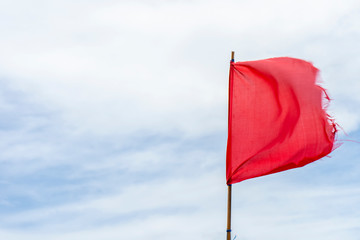 Red flag warning flags wind blue sky