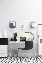 Comfortable workplace with modern laptop on desk. Home office