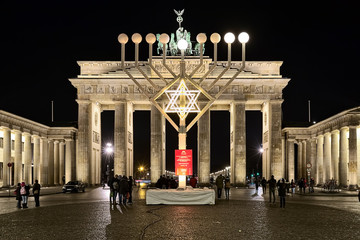 Berlin, Germany. Hanukkah menorah at Pariser Platz (Paris' square) in front of Brandenburg Gate in night.