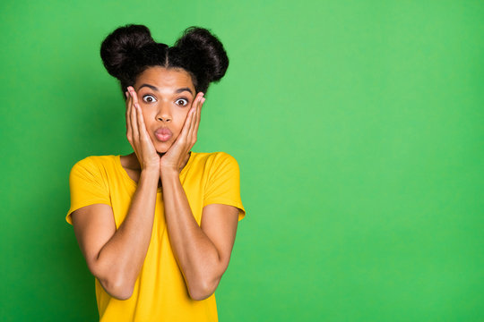 Closeup photo of pretty dark skin lady holding arms on cheeks looking in stupor not happy high prices black friday is over wear casual yellow t-shirt isolated green background