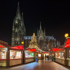 Cologne Cathedral Christmas Market in night, Germany. This is the most popular and best-known of all the city markets in front of the famous Cologne Cathedral.