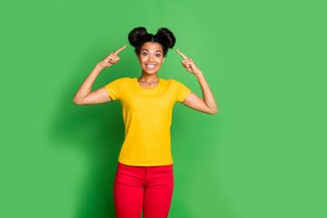 Photo of amazing dark skin lady indicating fingers on stylish hairdo advising visit cool salon hair...