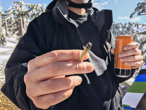 Man with Joint, Beer, and Snowboard