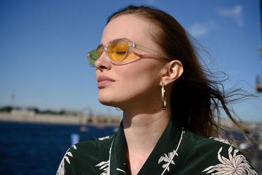 Portrait of young woman wearing stylish sunglasses