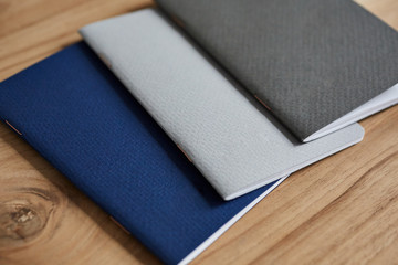 Small notebooks on a wooden desktop