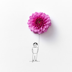 Composition from a pink flower and drawing men on a gray backgro