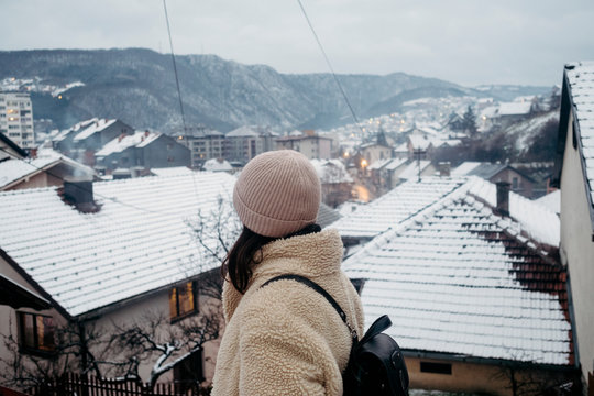 Anonymous female traveler exploaring the city during the winter