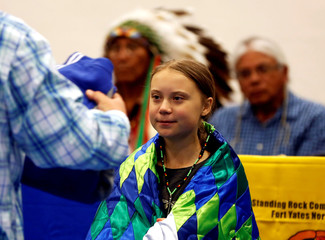 Climate change environmental activist Greta Thunberg receives gifts after speaking at a youth panel at the Standing Rock Indian Reservation, North Dakota