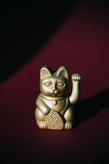Fotobehang Historisch mon. golden Maneki-neko, good fortune cat