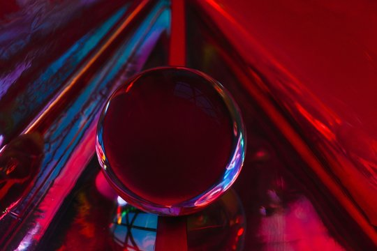 Stylish texture with magic crystal ball on dark red colorful background