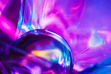 Abstract shots of crystal ball on light violet colorful backdrop