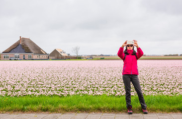 Woman take a selfie at colorful flower field
