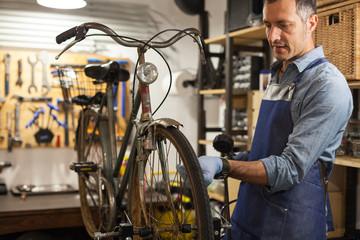 Artisan fixing a bike