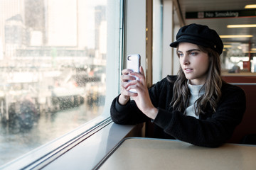Stylish Woman Taking Picture in a Ferry