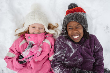 Caucasian and Black Girls in Snow