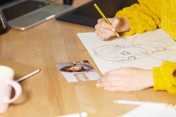 Woman drawing with pencil on paper