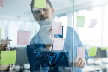 Businessman Writing on Post-It Notes