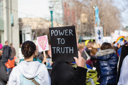 """Protest sign reading : """"""""power to truth"""""""""""