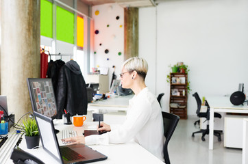 Woman working in modern office with gadgets