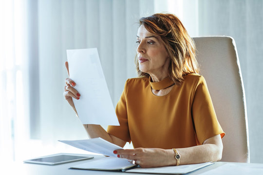 Middle-Aged Businesswoman Working at her Office