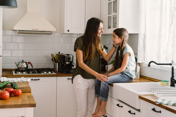 Mother and daughter bonding in the kitchen