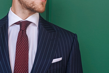 Man wearing pinstripe blazer with spotted tie