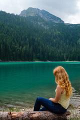 Young teenager girl on Black lake. Montenegro