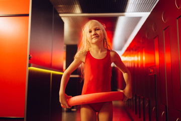 Little girl and red pool noodle