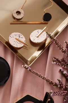 Earrings on golden tray