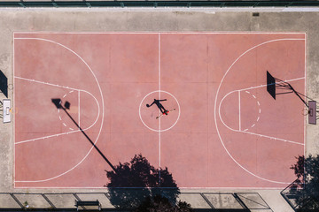 Player on basketball sports ground from drone
