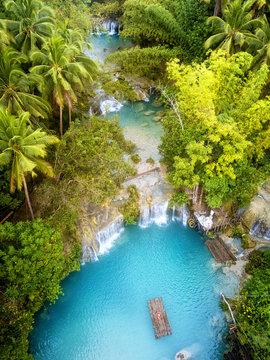 Woman exploring Cambugahay Falls in Siquijor, Philippines