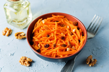 Carrot walnut raisin salad with glass of water