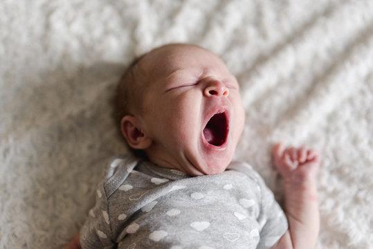 newborn baby yawning