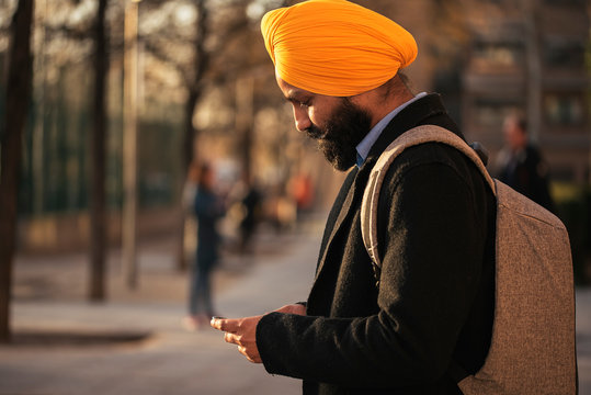Young handsome Indian Sikh in the street