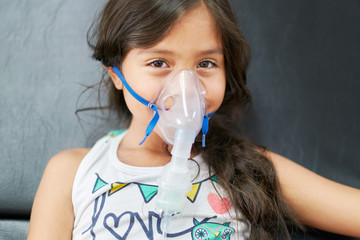 Girl in hospital with respiratory difficulties receiving treatment