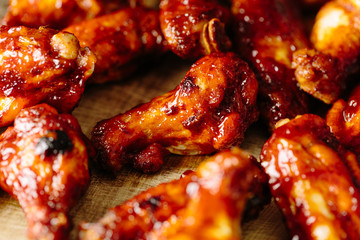 Detailed close up of cooked BBQ chicken wings