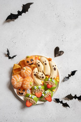 Healthy Halloween Treats. Banana Ghosts, Clementine Orange Pumpkins and Apple Monster Mounts