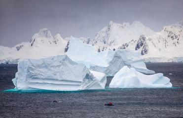 Inflatable boat amongst icebergs