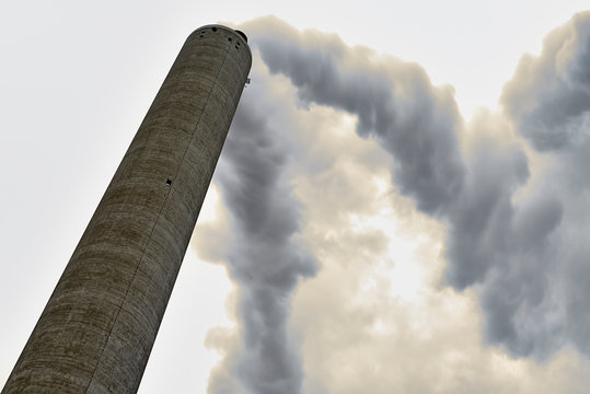 Long exposure of smoke coming out of a factory chimney