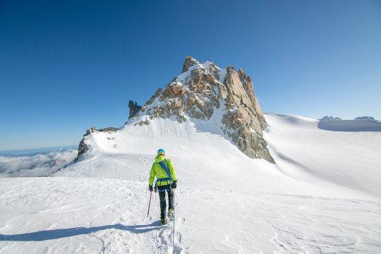 Alpinist crosses a gentle glacier en route to the aiguille du midi