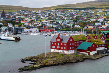 Colorful traditional houses in Tórshavn harbor, Faroe Islands. Urban scene of scandinavian city in North Atlantic