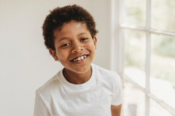 Portrait of smiling school-aged boy looking at camera
