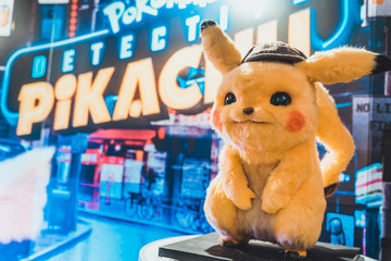 Bangkok, Thailand - May 2, 2019: Pikachu doll display by Pokemon Detective Pikachu animation movie backdrop in movie theatre. Cartoon comic character, or cinema film promotional advertisement concept
