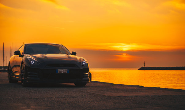 SISTIANA, ITALY JUNE 12, 2013: Photo of a Nissan GT-R Black Edition at the sunset. The Nissan GT-R is a 2-door 2+2 sports car produced by Nissan and unveiled in 2007.