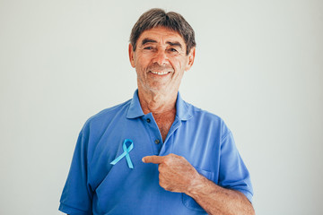 Prostate Cancer Awareness. Man with light Blue Ribbon for supporting people living and illness. Men Healthcare and World cancer day concept