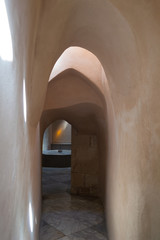 Aged narrow stone vaulted passage, historical traditional Hamam Inal public bathhouse, Cairo, Egypt