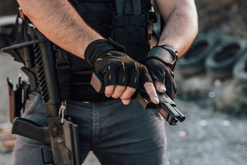 Close-up image of a mercenary with all kinds of weapon, close-up.