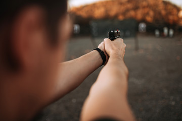 Shooting from handgun, personal point of view, close-up.