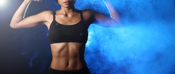 Asian Tan Skin Sport Girl in Fog Smoke Dark background environment Blue color, studio lighting, concept woman can do good health, copy space