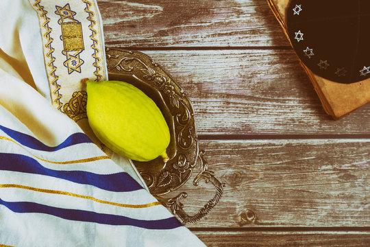 Sukkot Jewish festival of traditional religious symbol Etrog, lulav, hadas, arava kippah tallit praying book